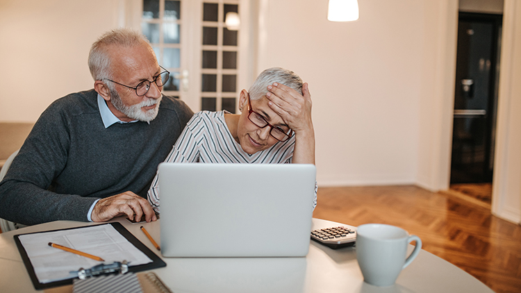 a senior couple researching the costs of aging in place