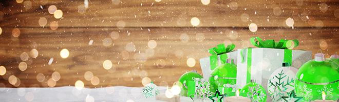 Green and white christmas gifts and baubles on snowy background 3D rendering