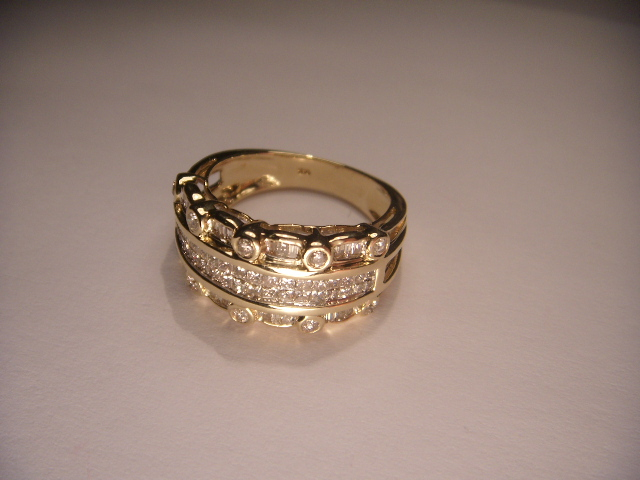 14K Yellow Gold Diamond Wedding Band This Beautiful Piece Features 10 Brilliant Round Diamonds 36 Princess Cut White And 24 Baguette