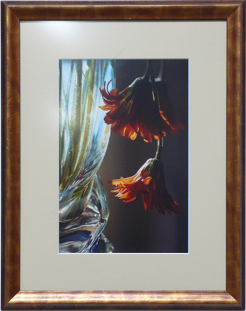 main photo of 2 Flowers Hanging From A Glass Vase
