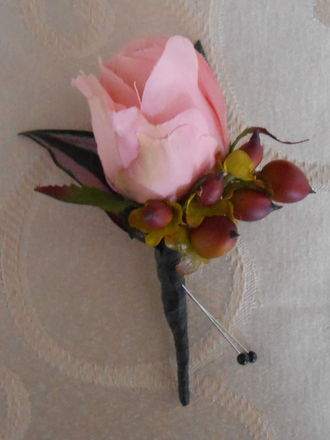 main photo of Pink rose boutonniere