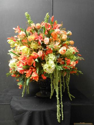 main photo of Orange floral arrangement