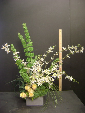 main photo of Orchids and bells of Ireland
