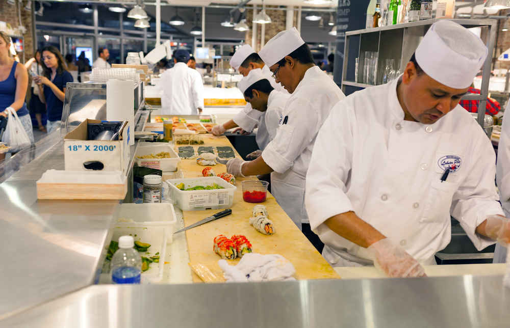 Sushi Chefs preparing food at Chelsea Market in Manhattan