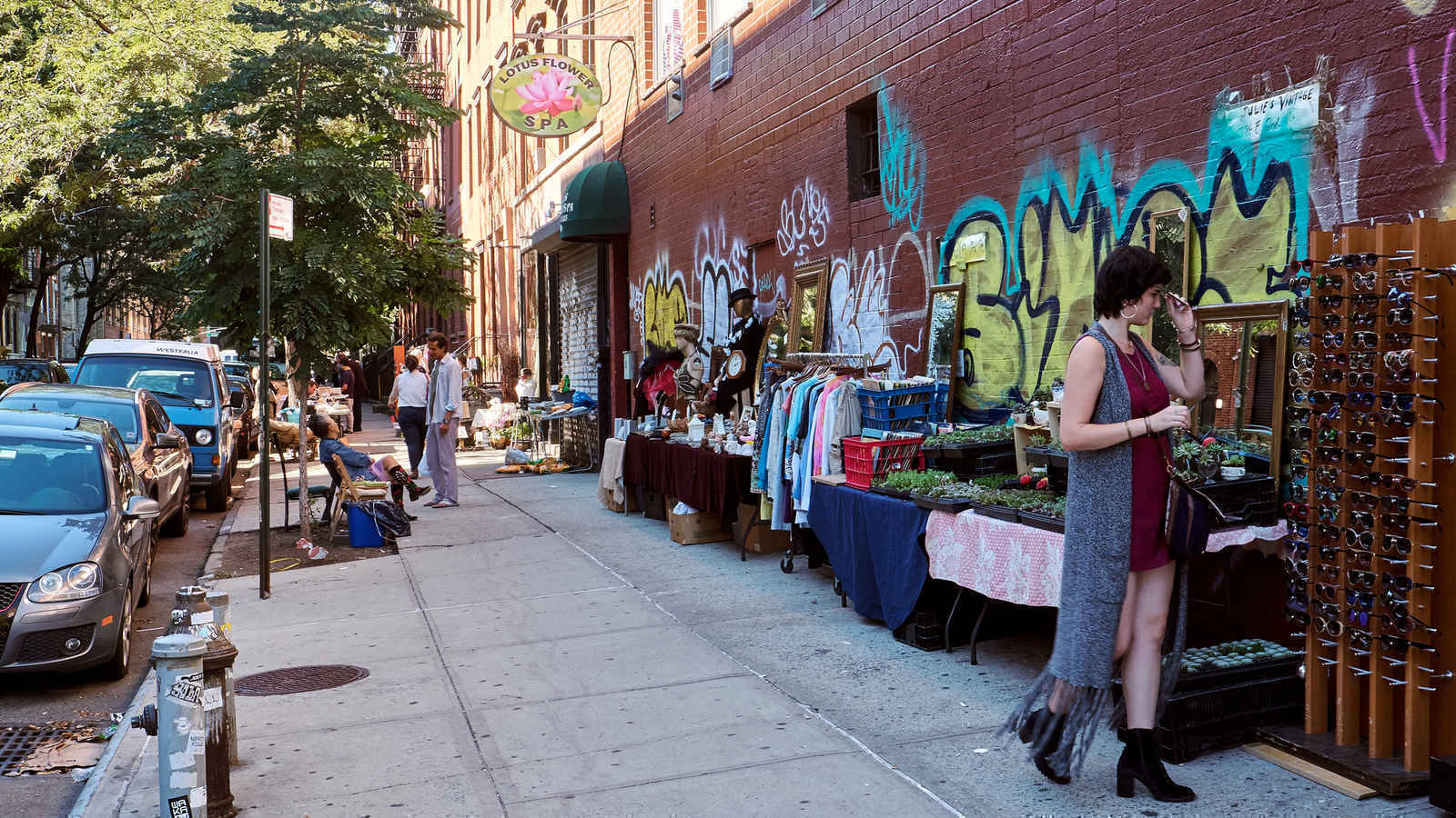 Woman browsing goods at a flea market in the East Village