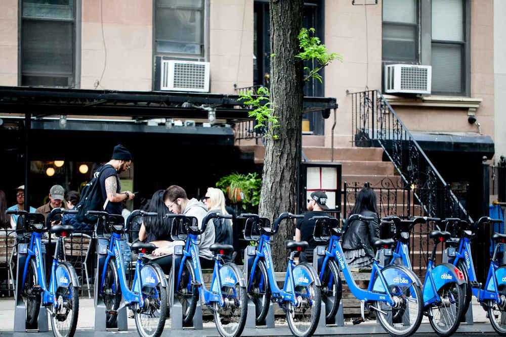 A citi bike station in front of a restaurant in the East Village, Manhattan
