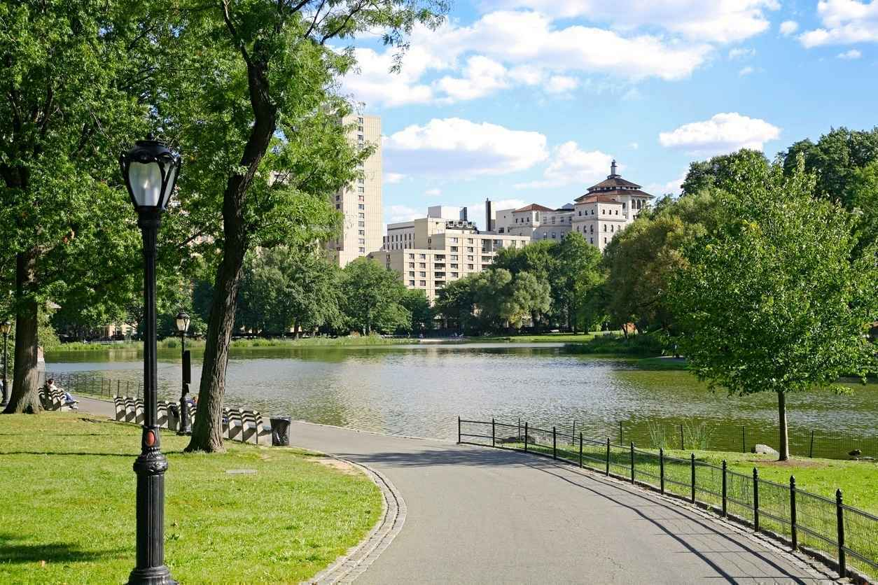 Panorama of Harlem Meer with Harlem skyline in background