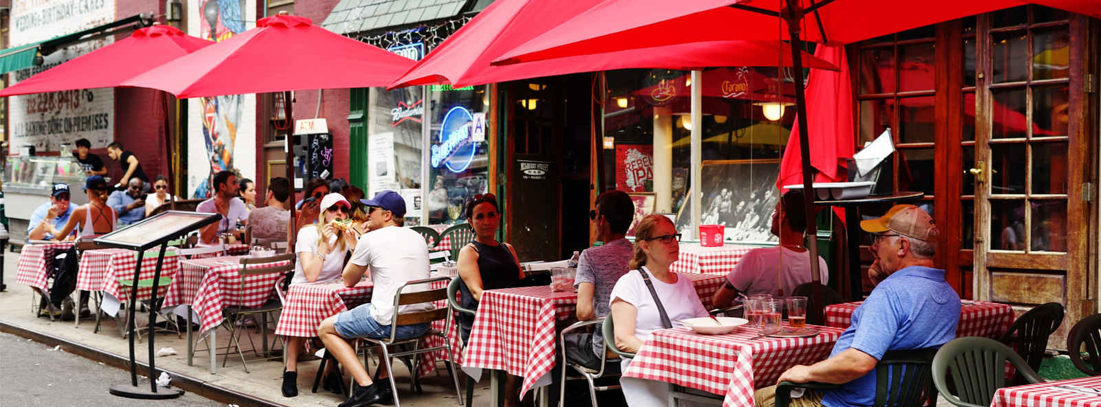 Diners at outdoor cafe in Little Italy, New York