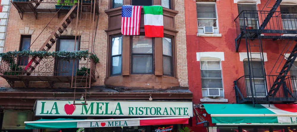 Buildings in Little Italy with hanging Italian and American flags
