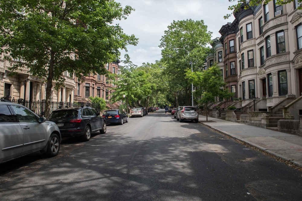 Brownstones and Townhouses on tree-lined street in Park Slope Brooklyn