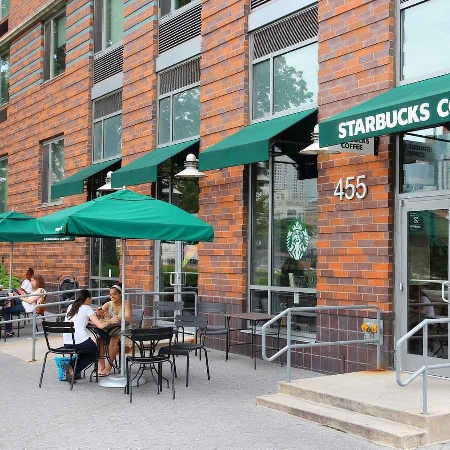 People having breakfast at a Starbucks coffee shop on Roosevelt Island
