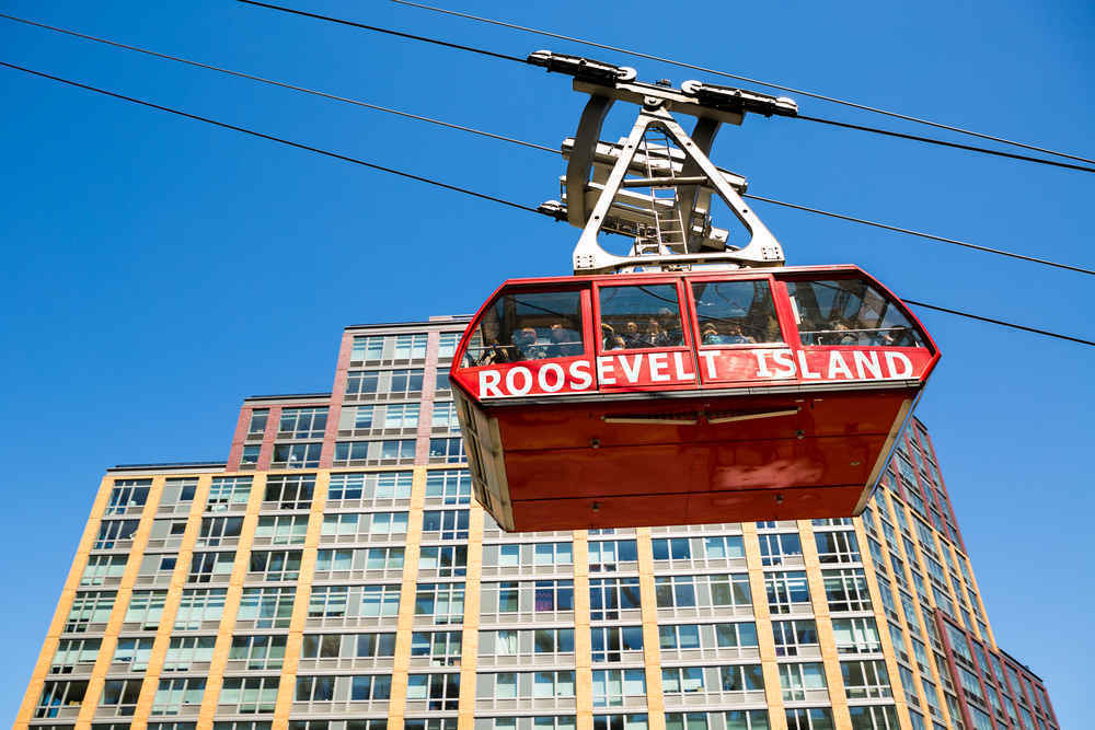 The Roosevelt Island Cable Car with a residential apartment building in the background
