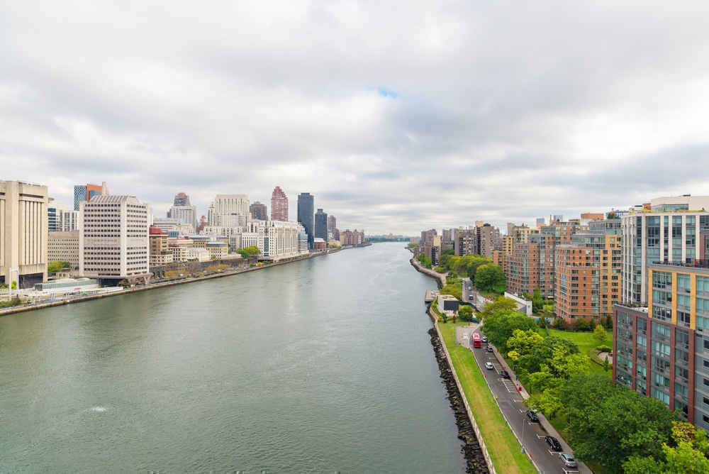 Roosevelt Island residential apartment buildings and the East River seen from the tramway