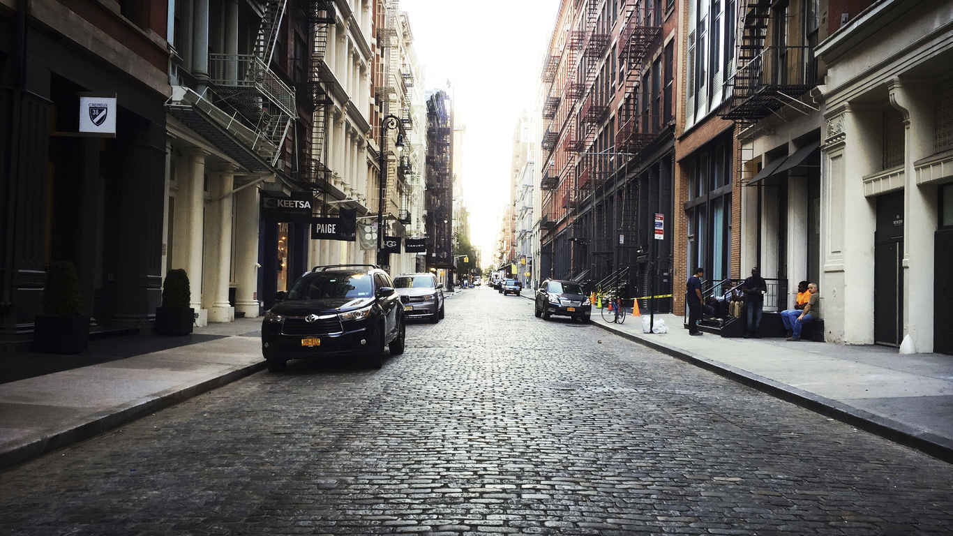 Shops, galleries and restaurants on a cobblestone street in Soho, New York