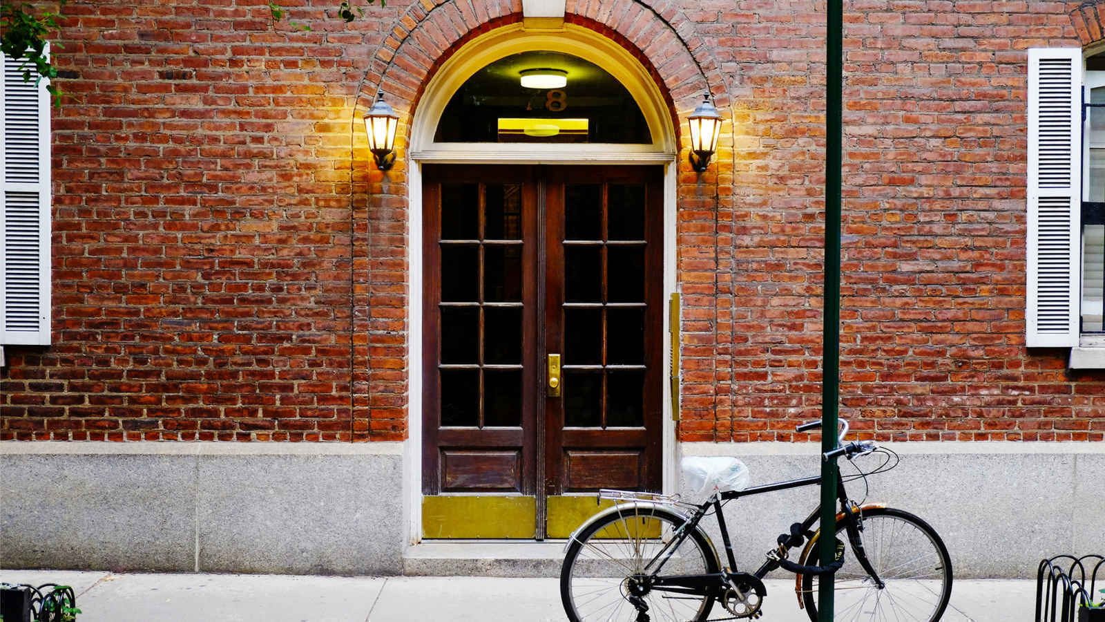 A bicycle outside a residential  building in Soho, New York