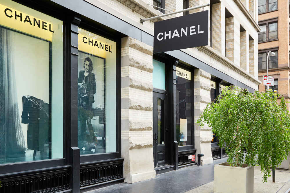 Chanel boutique and sign, located  at 139 Greene Street in Soho, New York