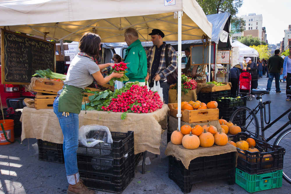 Fruit and vegetable vendors at Union Square Greenmarket in New York