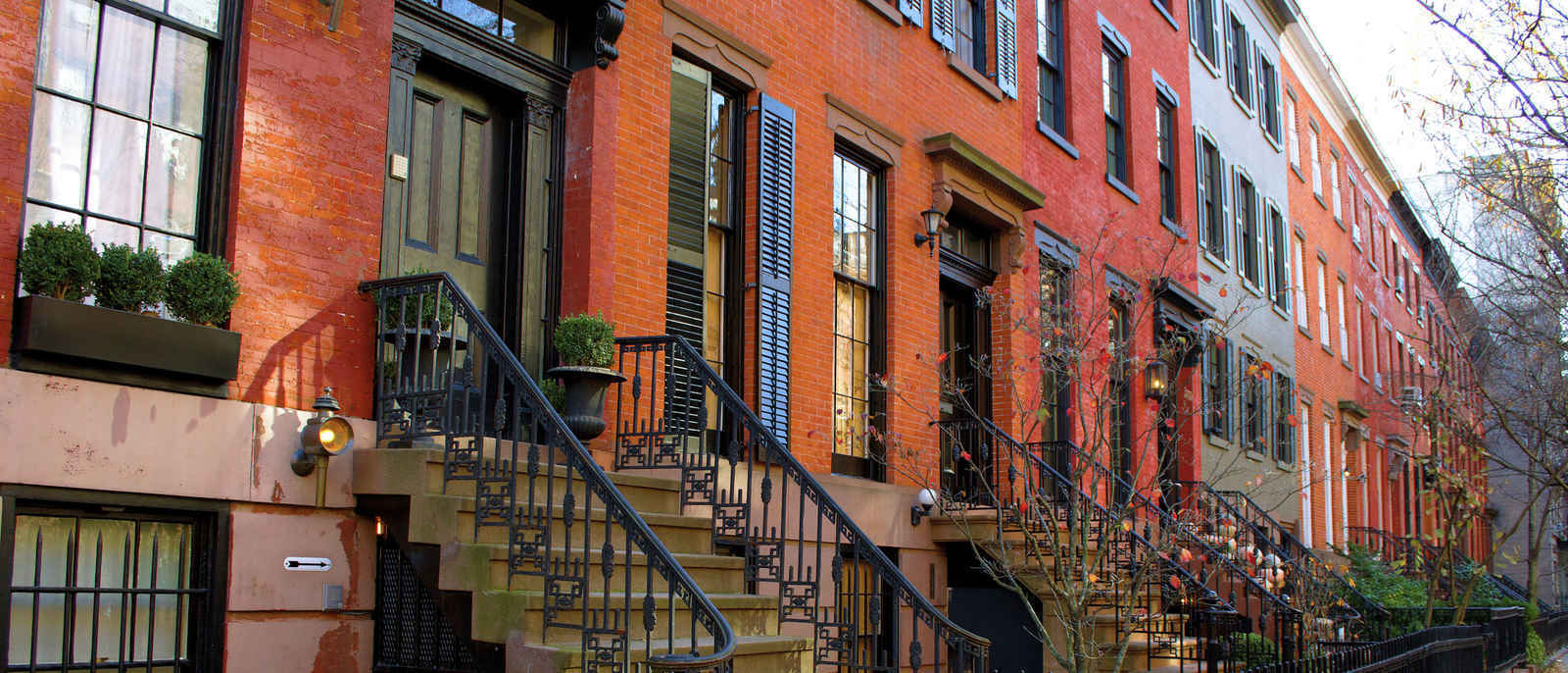 Townhouses on tree-lined street in the West Village, New York