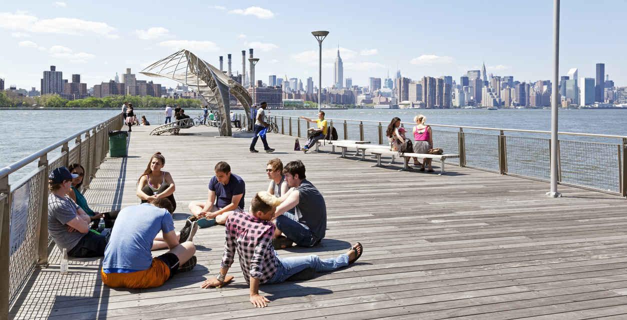 People relaxing at Northside Piers in Williamsburg, Brooklyn