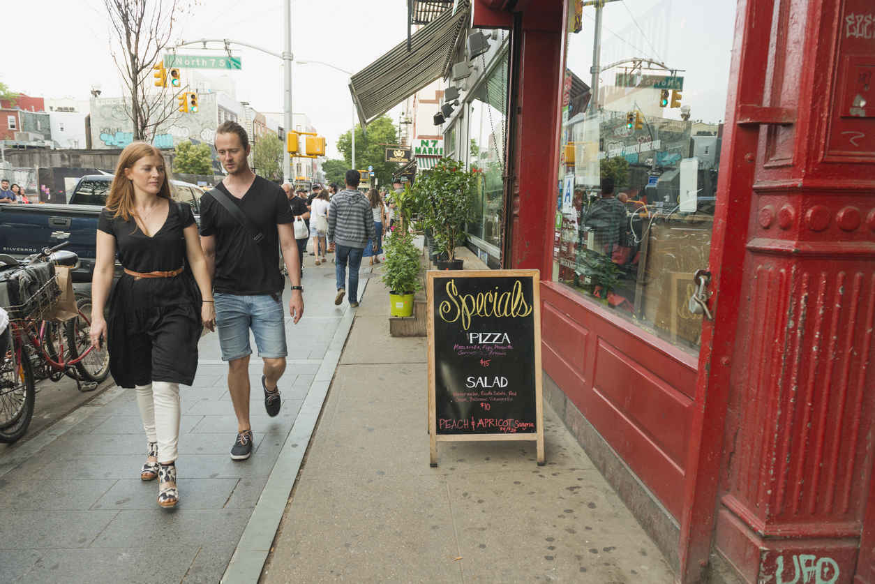 People walking by shops and restaurants on Bedford Ave, Williamsburg, Brooklyn