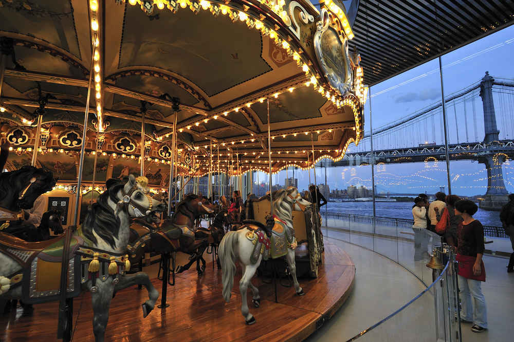 Families with children at Jane's Carousel  in Dumbo Brooklyn