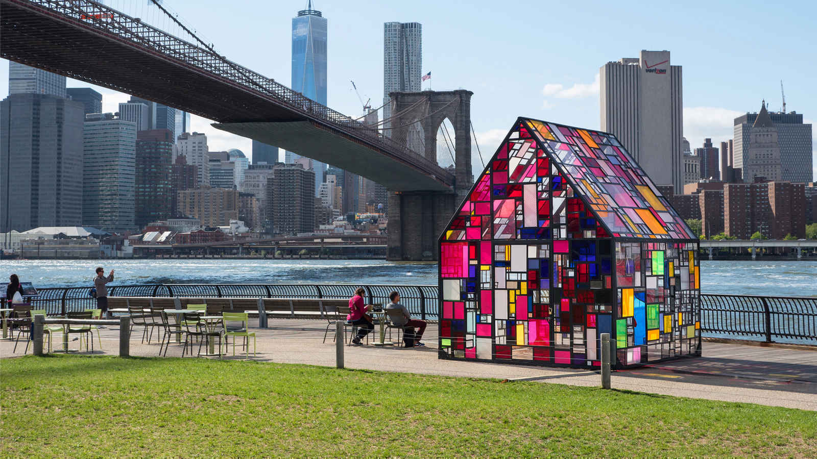 Stained glass art sculpture in Brooklyn Bridge Park, Dumbo, with views of the Manhattan skyline in background