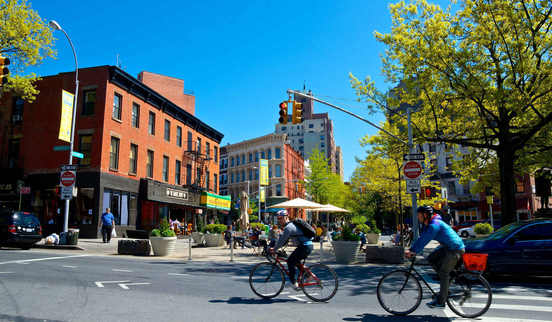People riding bikes by shops and restaurants in Fort Greene Brooklyn
