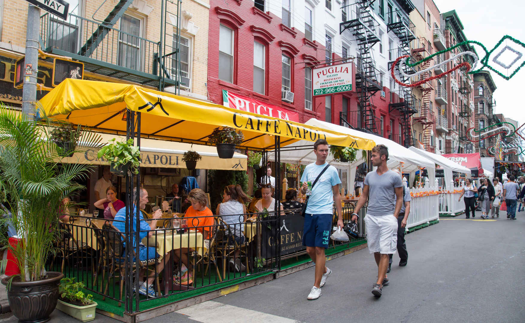 People dining at terrace of Cafe Napoli restaurant in Little Italy, New York