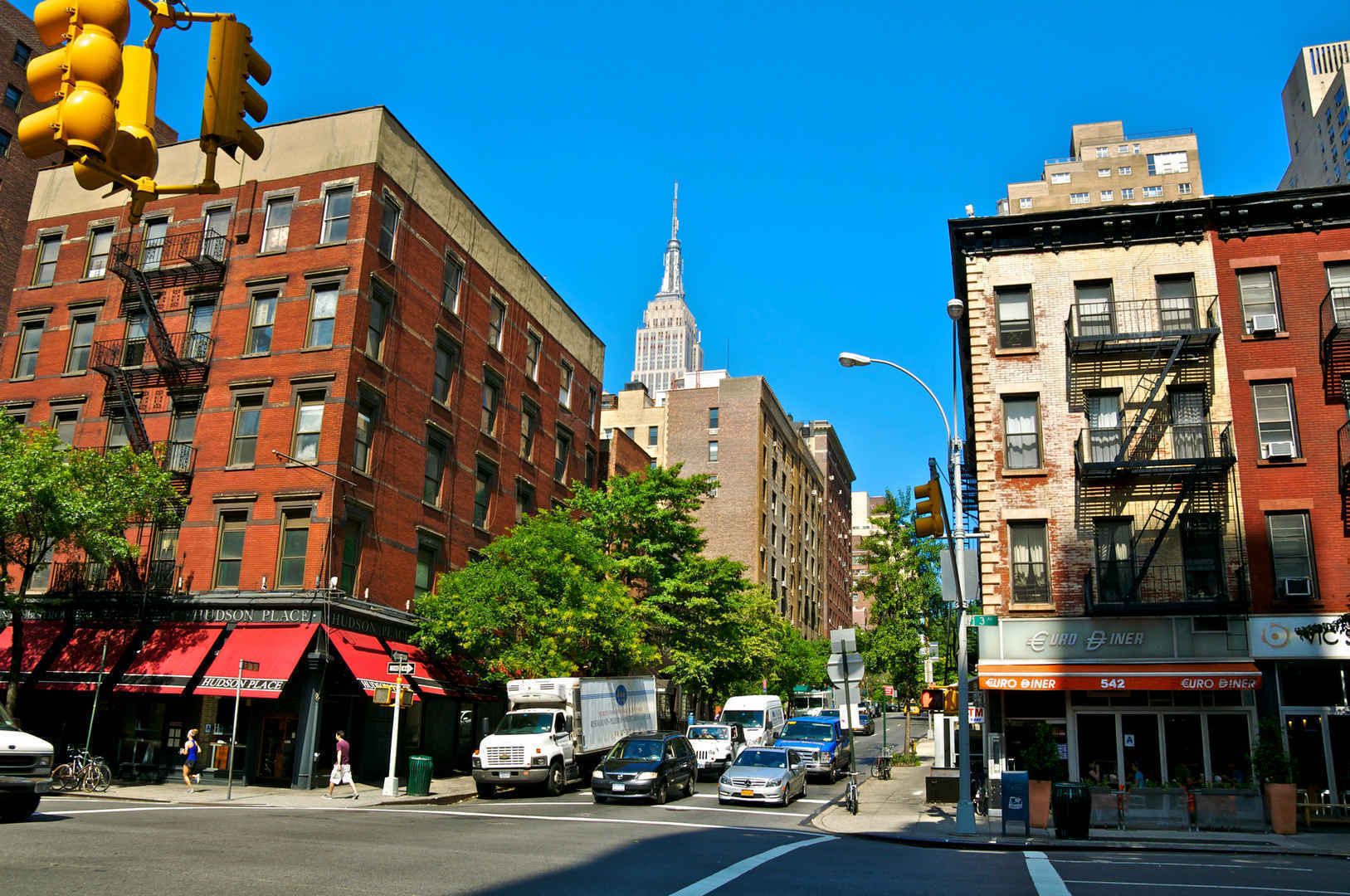 Shops and restaurants on tree-lined street in Murray Hill New York