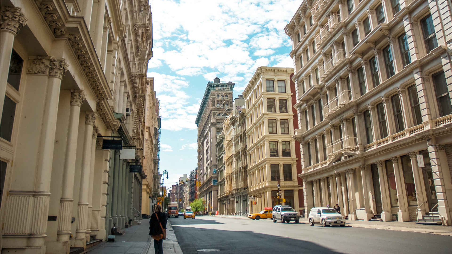 Panorama with historic cast-iron buildings on Soho, New York street