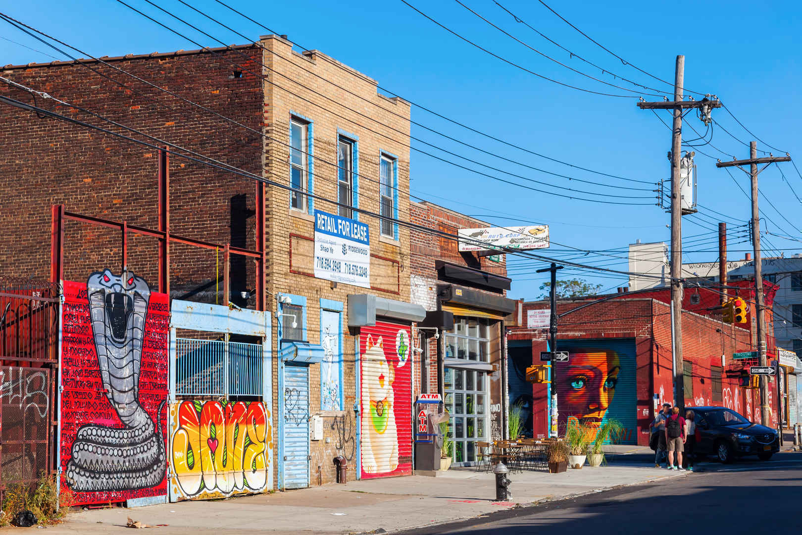 Residential street in Bushwick Brooklyn with graffiti mural art on buildings