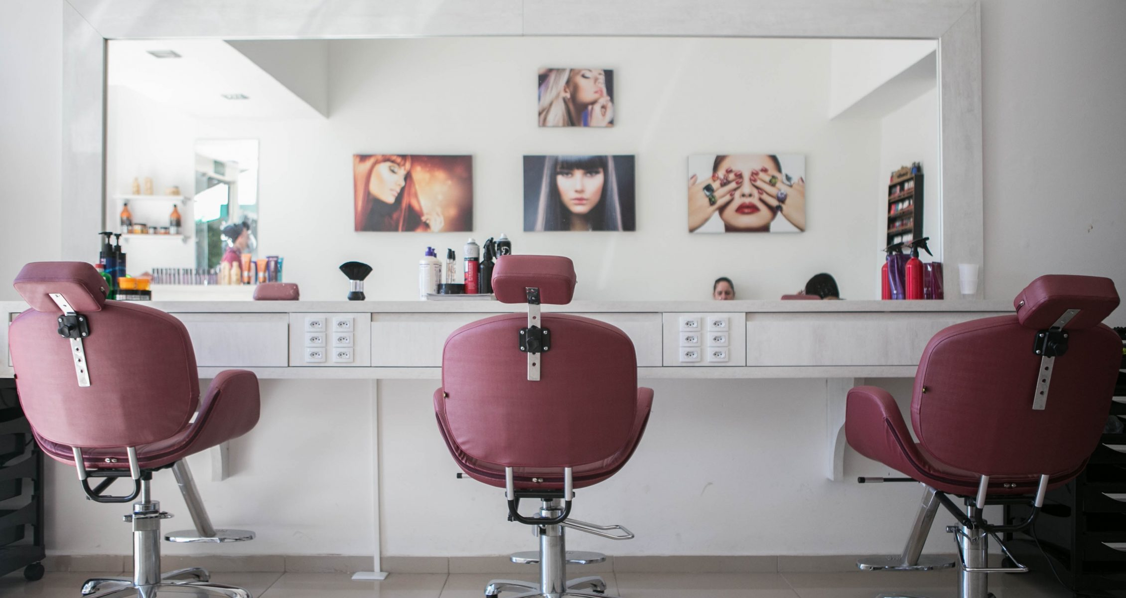 Hair salon with pink chairs