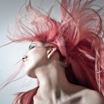 Woman flipping her pink hair