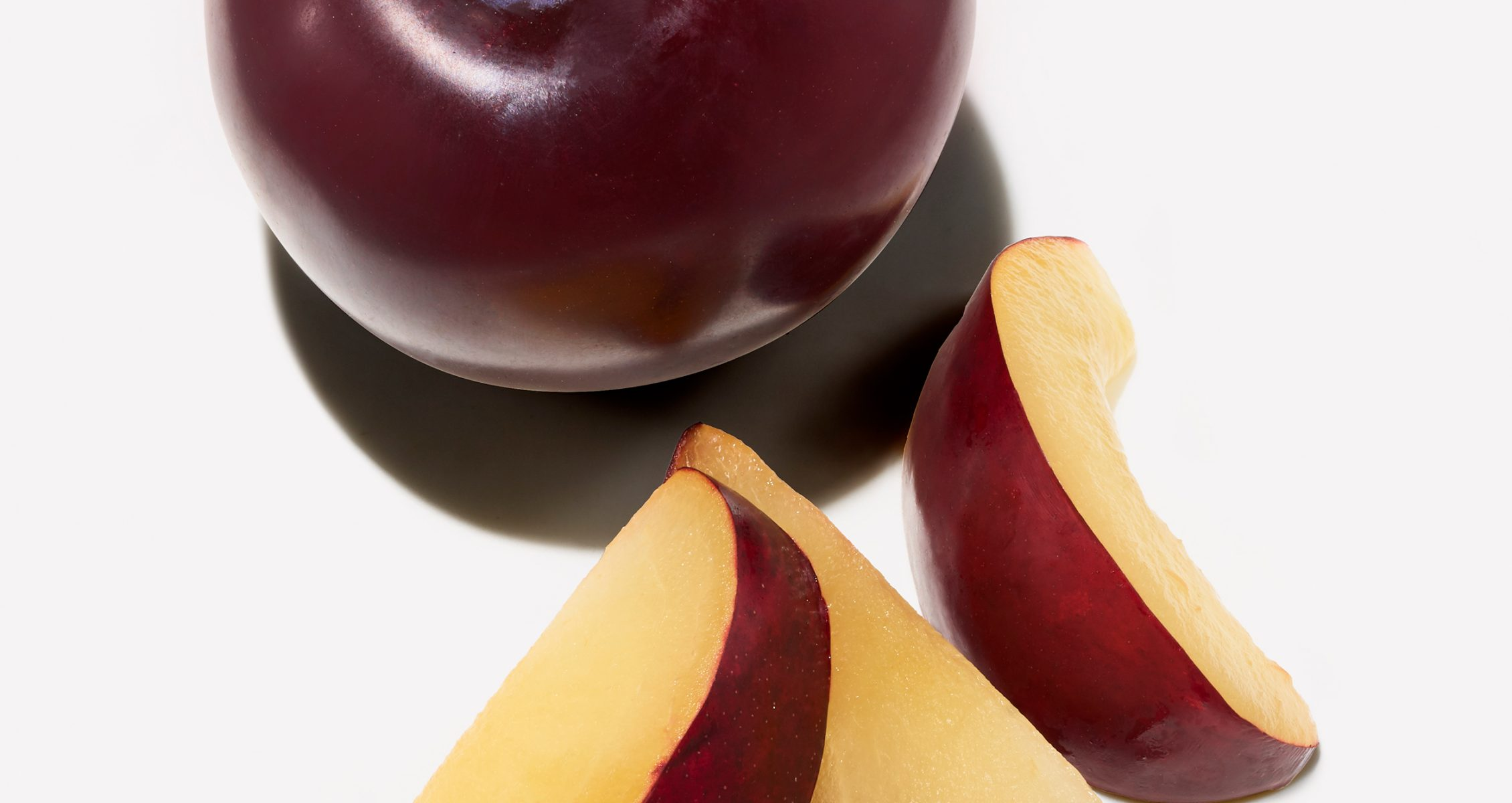 Sliced and whole plums