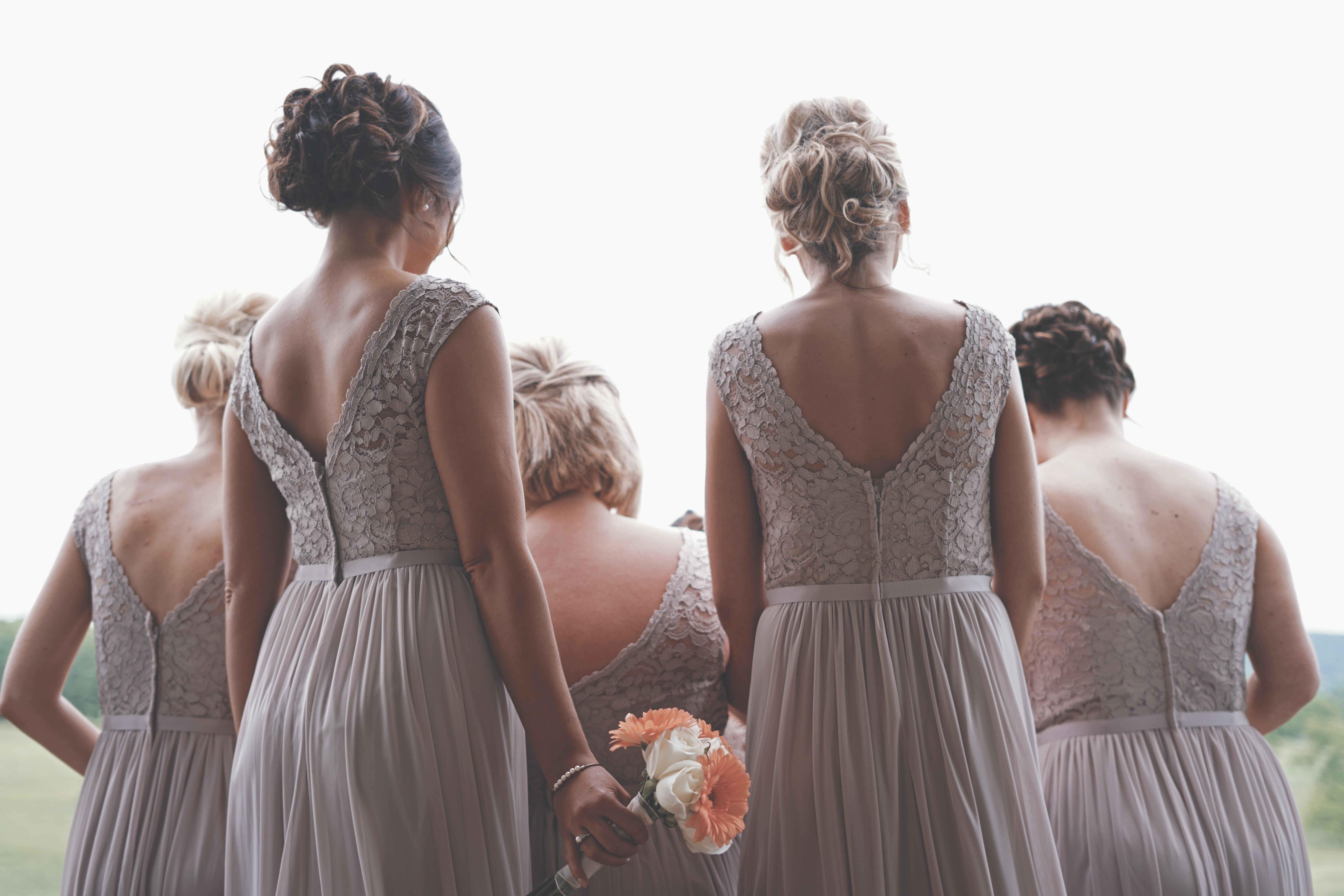 bridesmaids wearing purple dresses