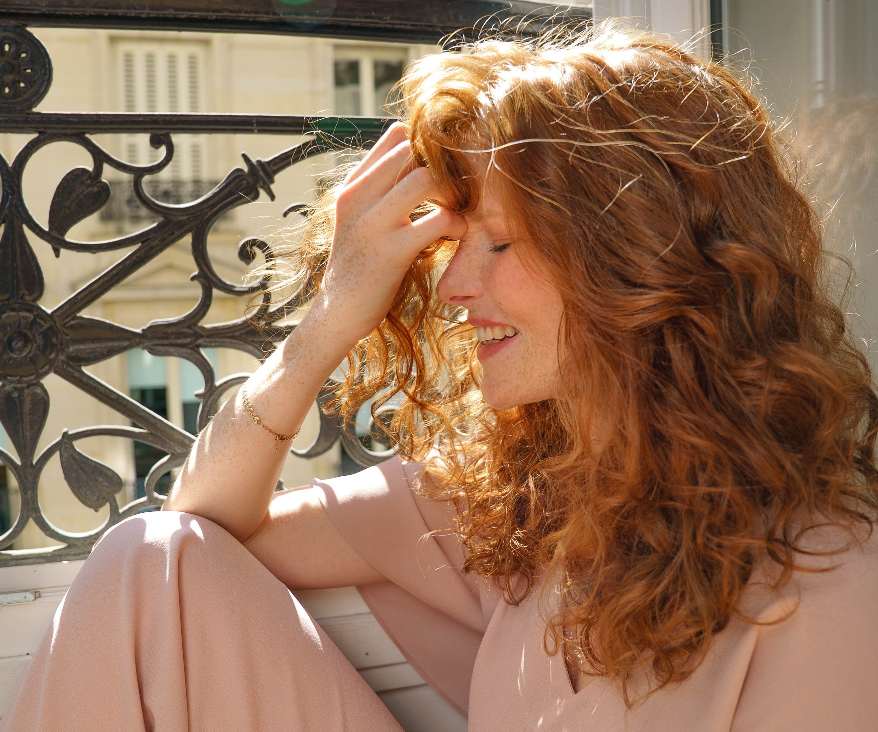 side profile of ginger haired women smiling