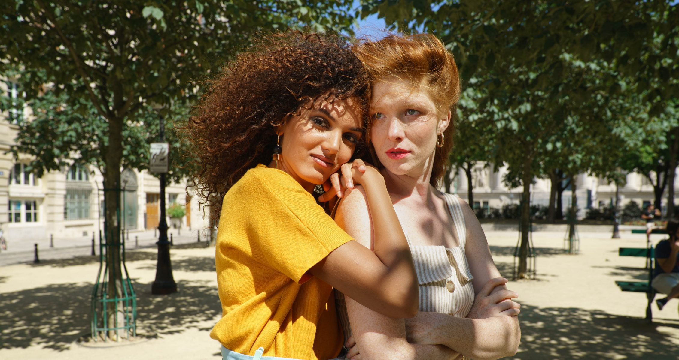 two women in a park in paris, france