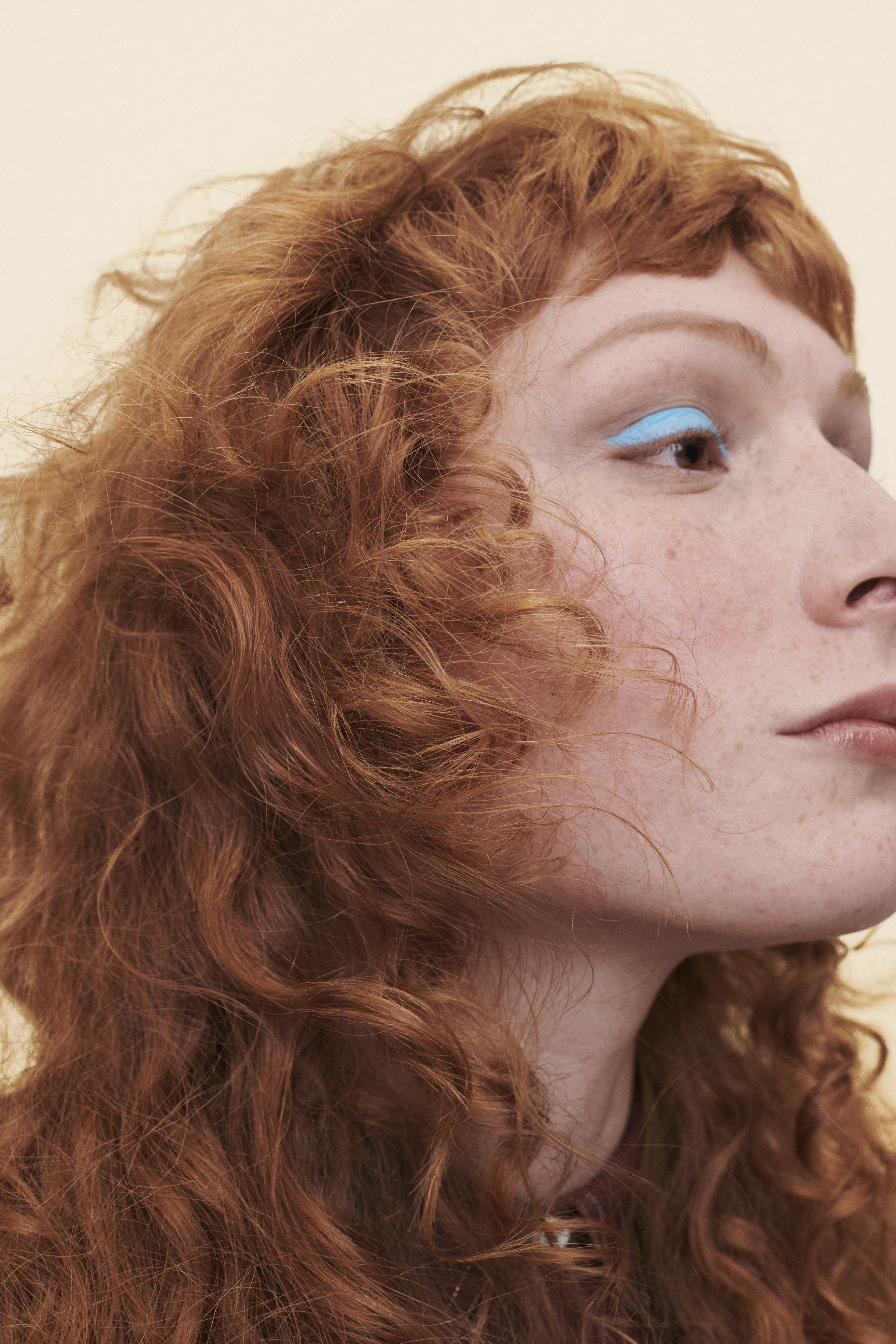 curly hair woman with red bangs