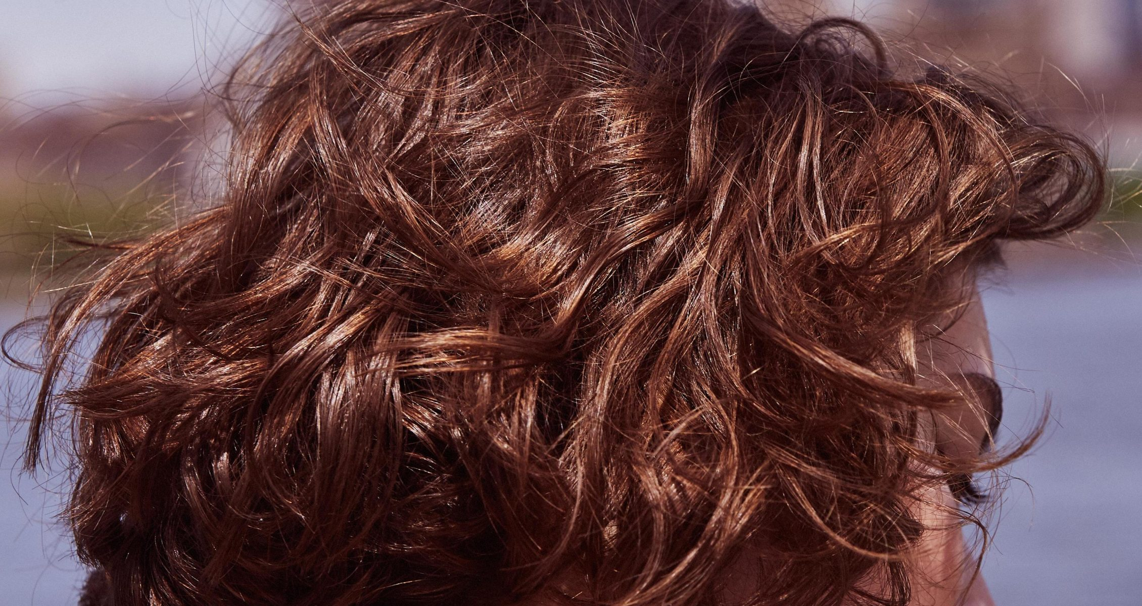 Prose model with short brown, wavy hair close up