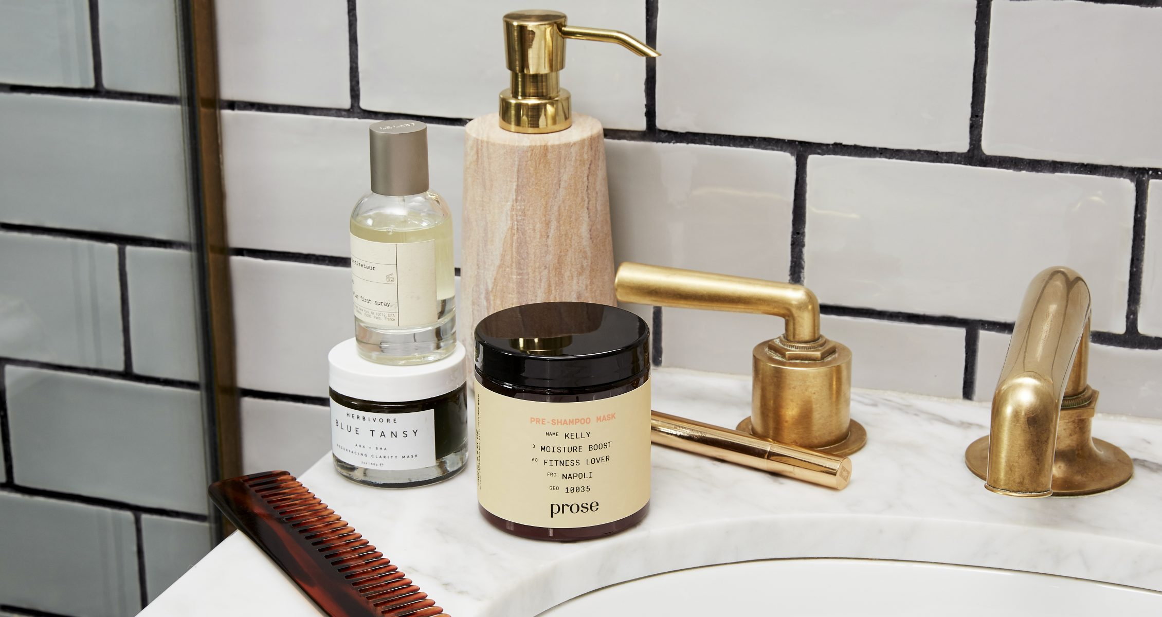 Prose product still on sink with comb and other beauty products