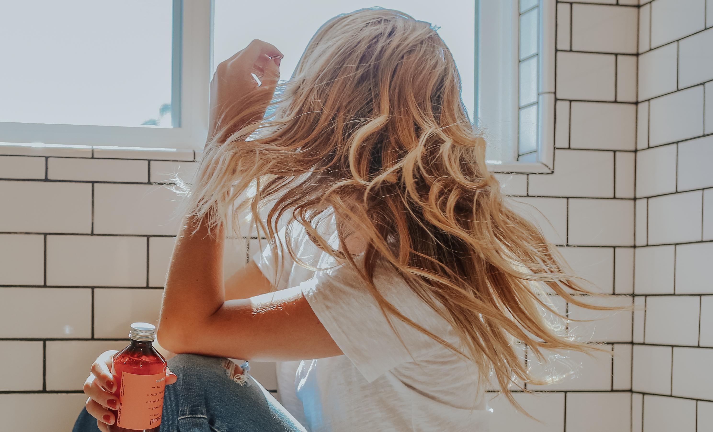 Prose blonde social model in white bathroom with her Prose