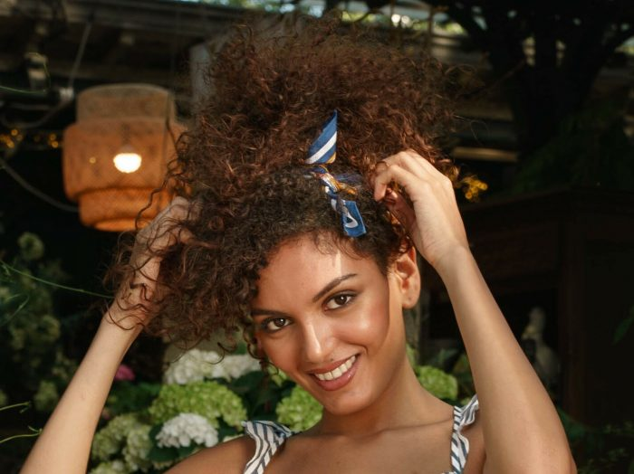 Prose model from Paris shoot with curly hair in front of greenery