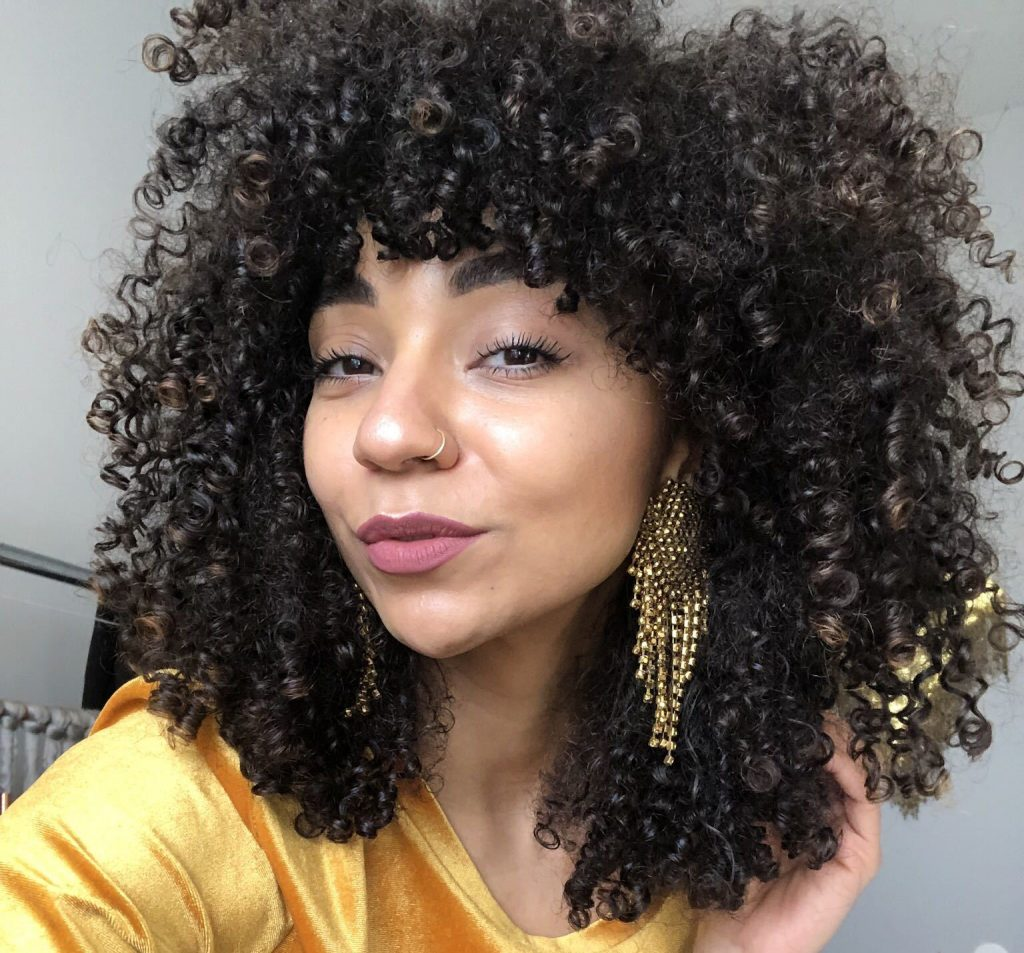 bangs trending summer haircut curly hair