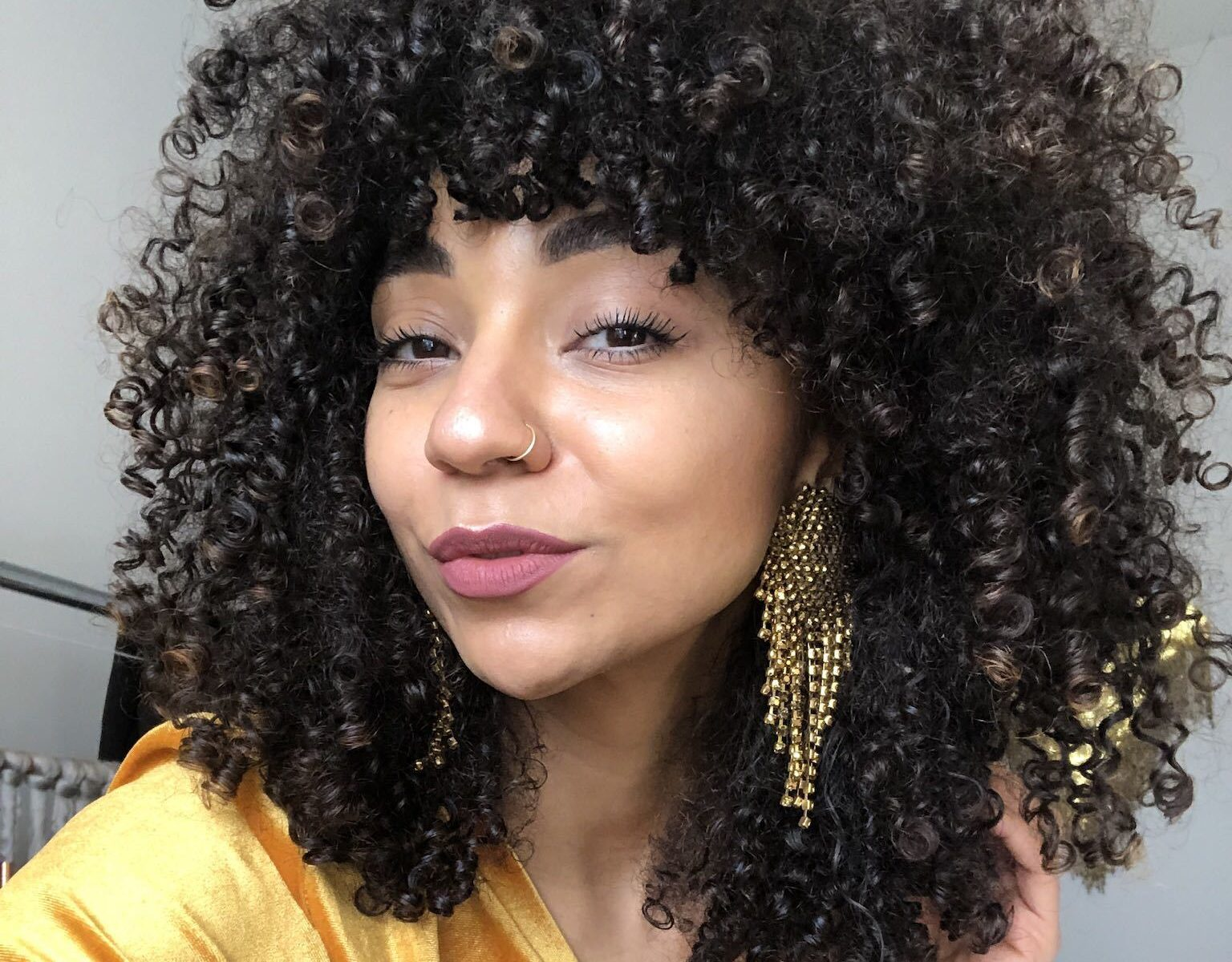 bangs trending summer haircut curly hair