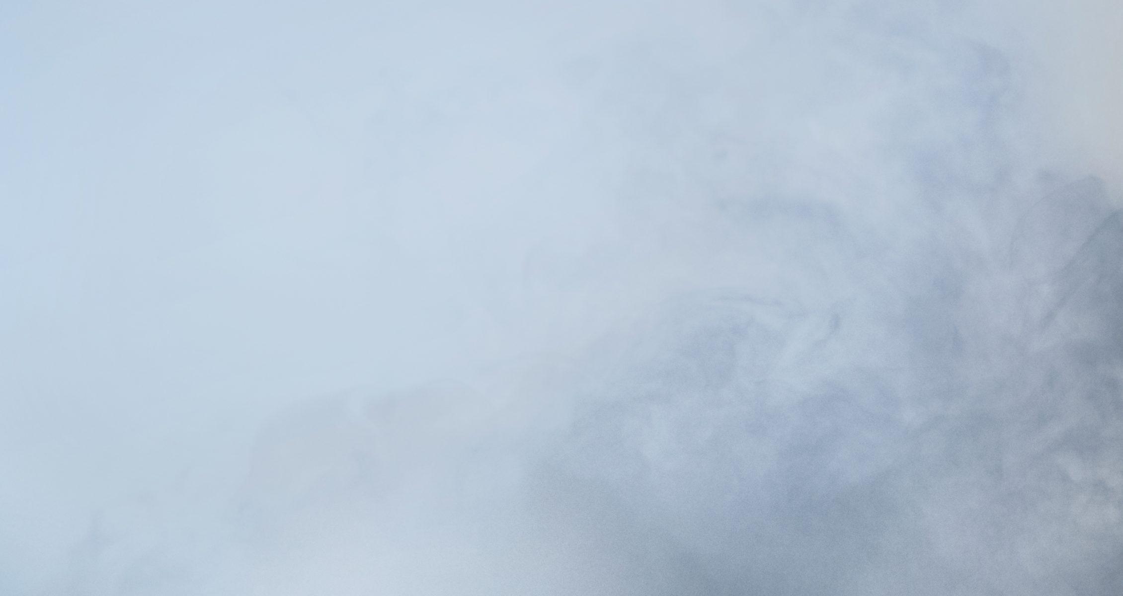 a puff of aerosol on a light blue background