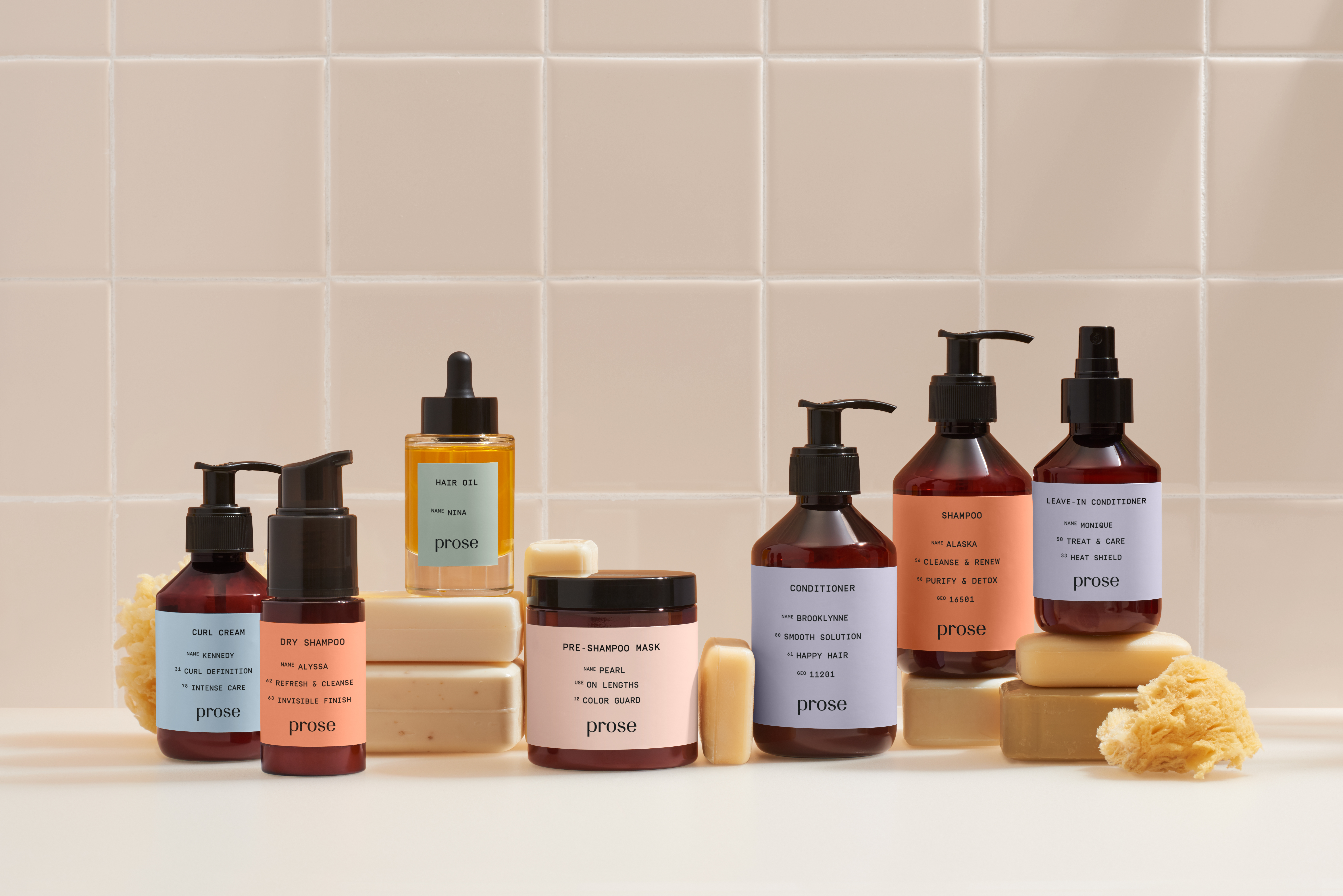 lineup of all prose products against a tan bathroom background
