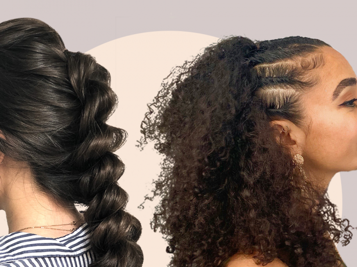 woman with her brown hair braided stands back to back with a woman with curly hair