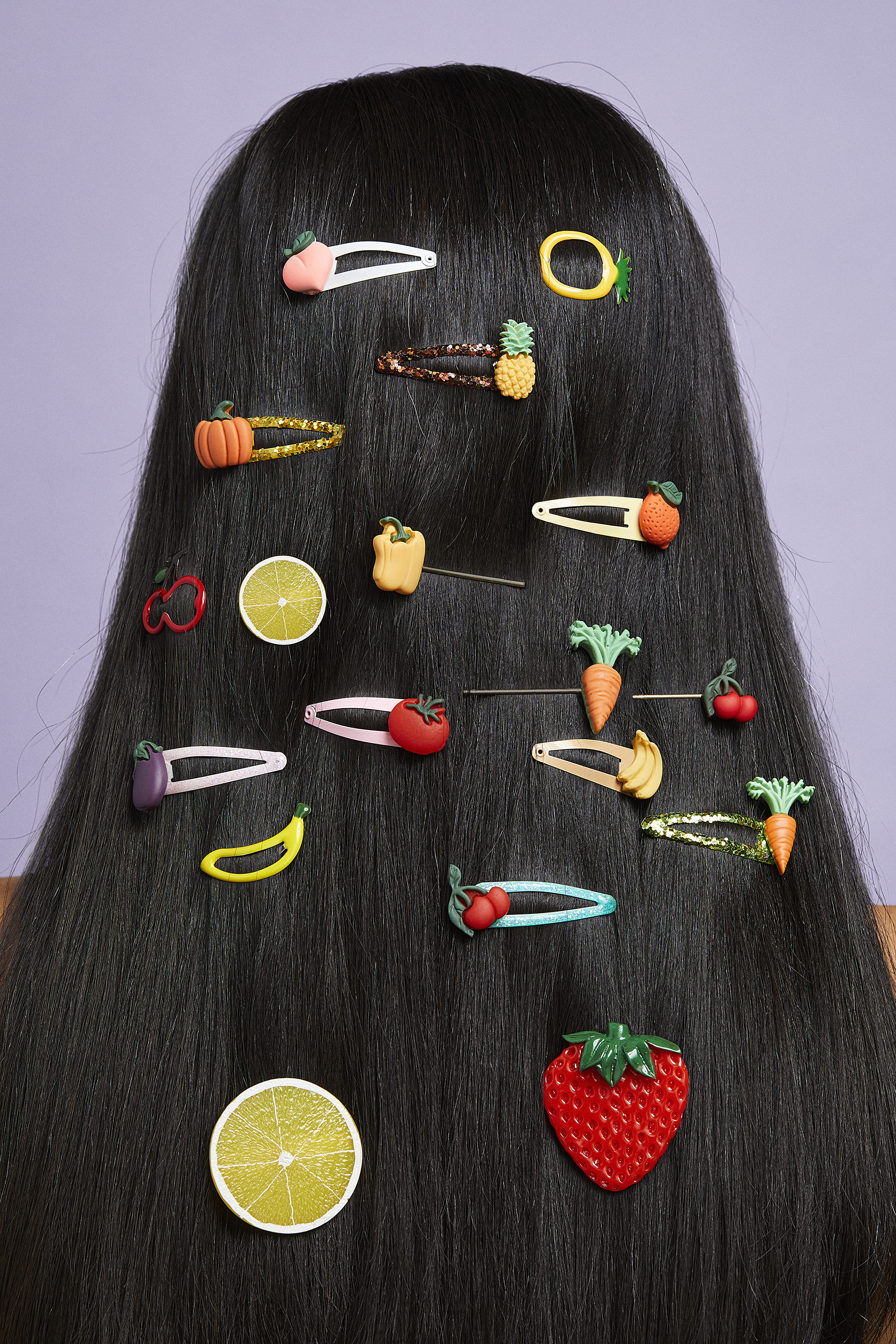woman with long, black, straight hair with fruit barrettes in her hair