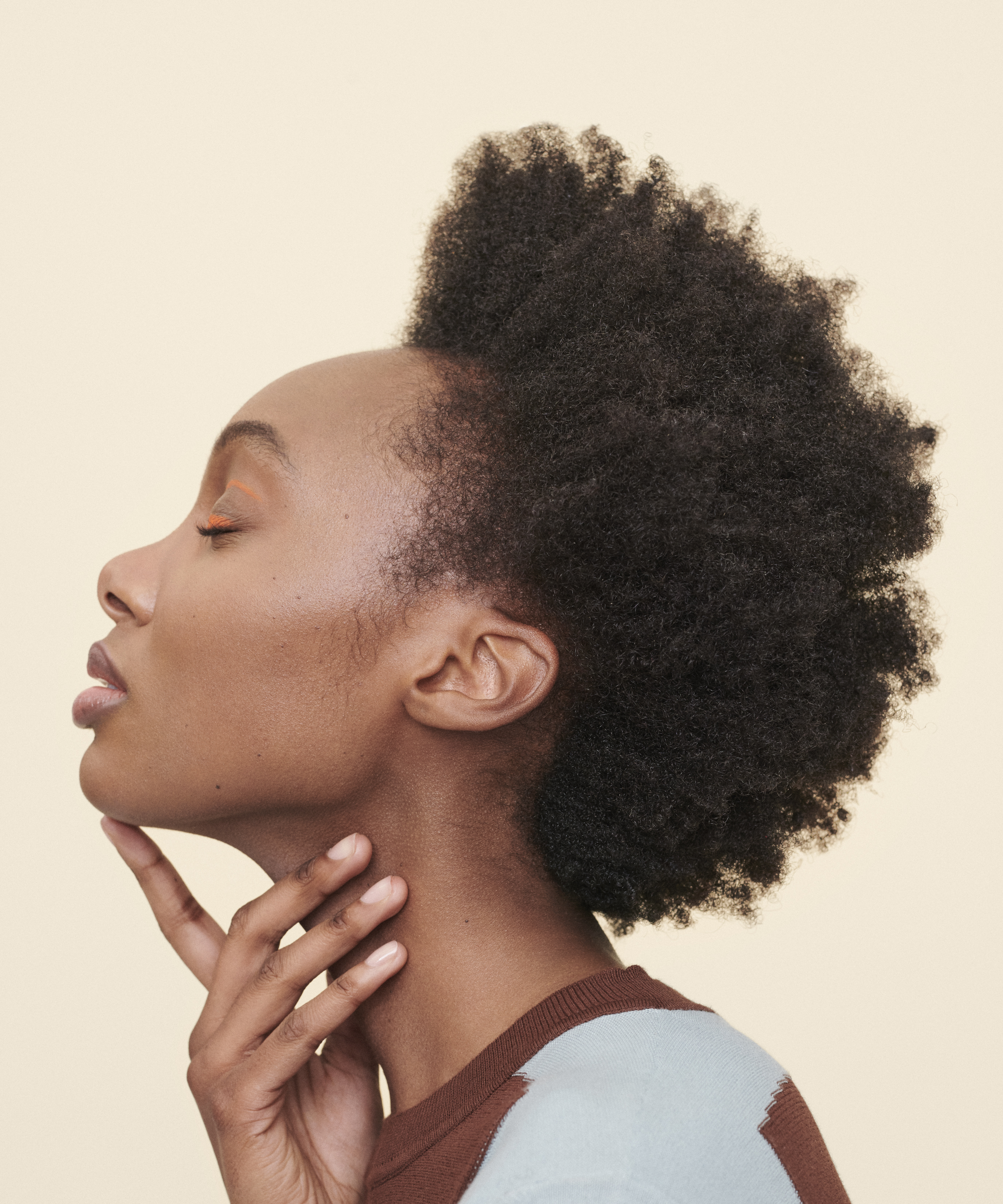 woman with short, curly hair with natural hair styles