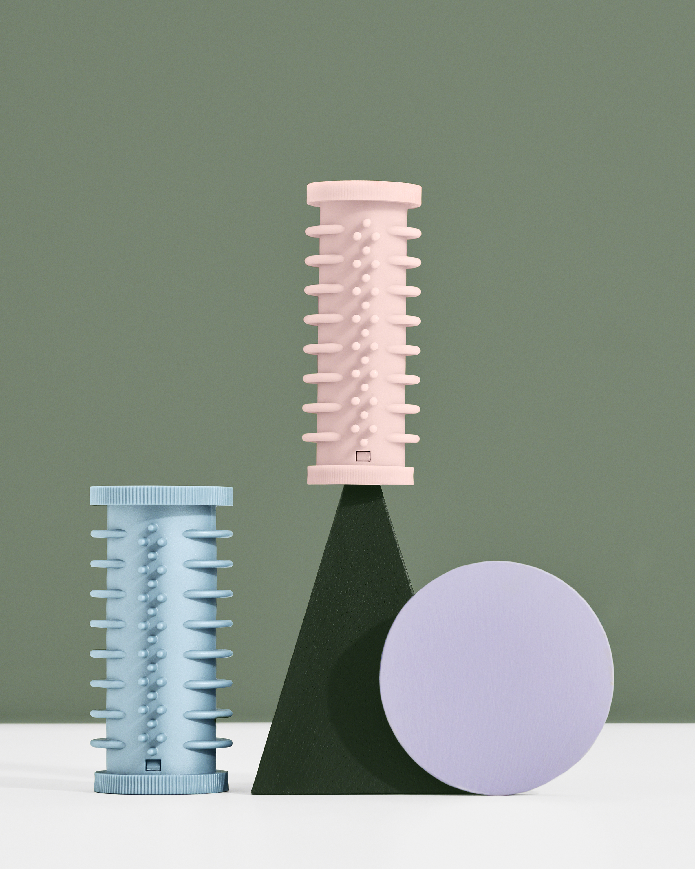 hair rollers on a graphic background